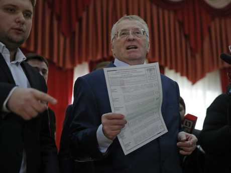 Vladimir Zhirinovsky, ultranationalist Liberal Democratic Party leader, speaks as he prepares to vote in the presidential election. Picture: AP/Pavel Golovkin