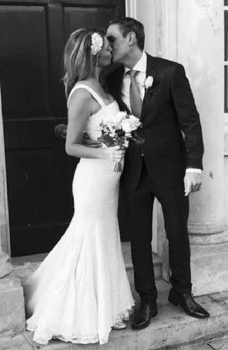 Lina Dahlbeck and husband Matthew Evangelou on their wedding day. The couple can't believe they met through a mistaken text. Picture: The Sun