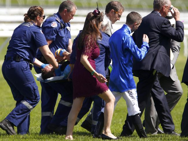 Jockey Hugh Bowman is carried off the Randwick track on Guineas Day. Picture: AAP