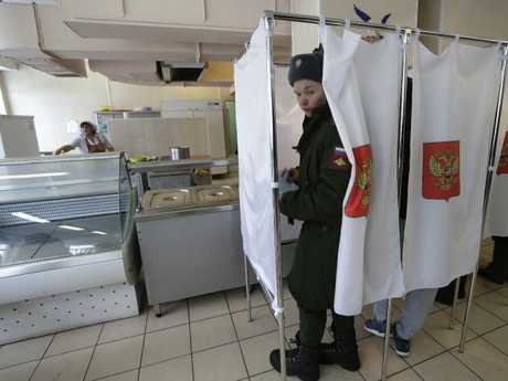 A Russian soldier at the voting booth. Picture: AP/Dmitri Lovetsky