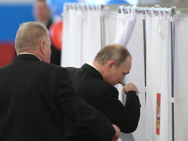 Vladimir Putin casts his vote. Picture: AFP/Sergei Chirikov