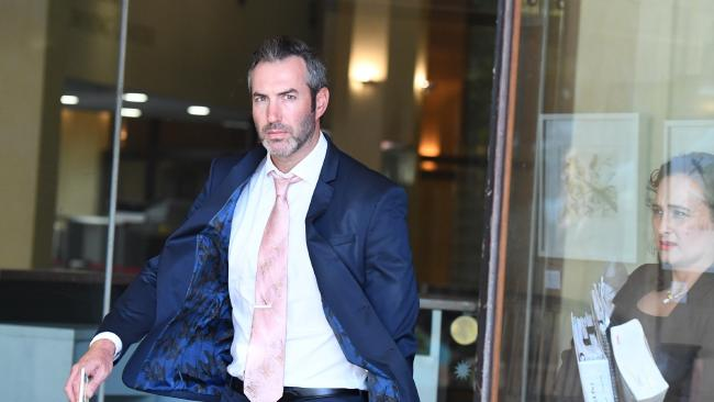 Liam Gordon Murphy leaves the Downing Centre Courts in Sydney, Monday, March 19, 2018. Picture: AAP /Peter Rae.