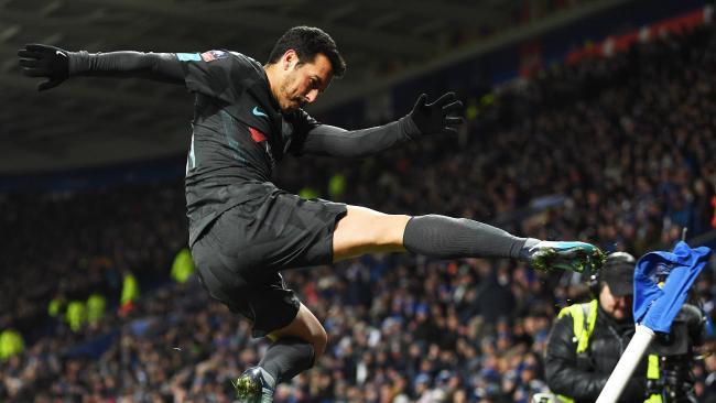Pedro of Chelsea kicks the corner flag as he celebrates scoring their second goal