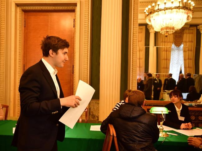 Russian chess grand master Sergey Karjakin prepares to cast his vote. Picture: AFP/ Tobias Schwarz
