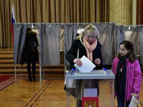 A woman votes at the Russian embassy in Berlin. Picture: AFP/Tobias Schwarz