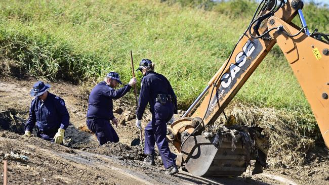 Police forensic officers searching Bowen dump for clues to the disappearance of Rachel Antonio. Picture: Wesley Monts