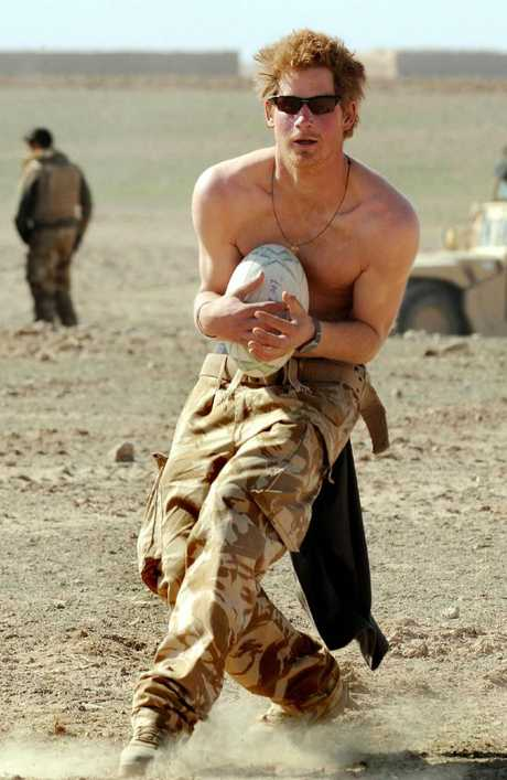 Prince Harry practices his rugby skills during a break in the desert on January 2, 2008 in Helmand Province, Afghanistan. Picture: John Stillwell