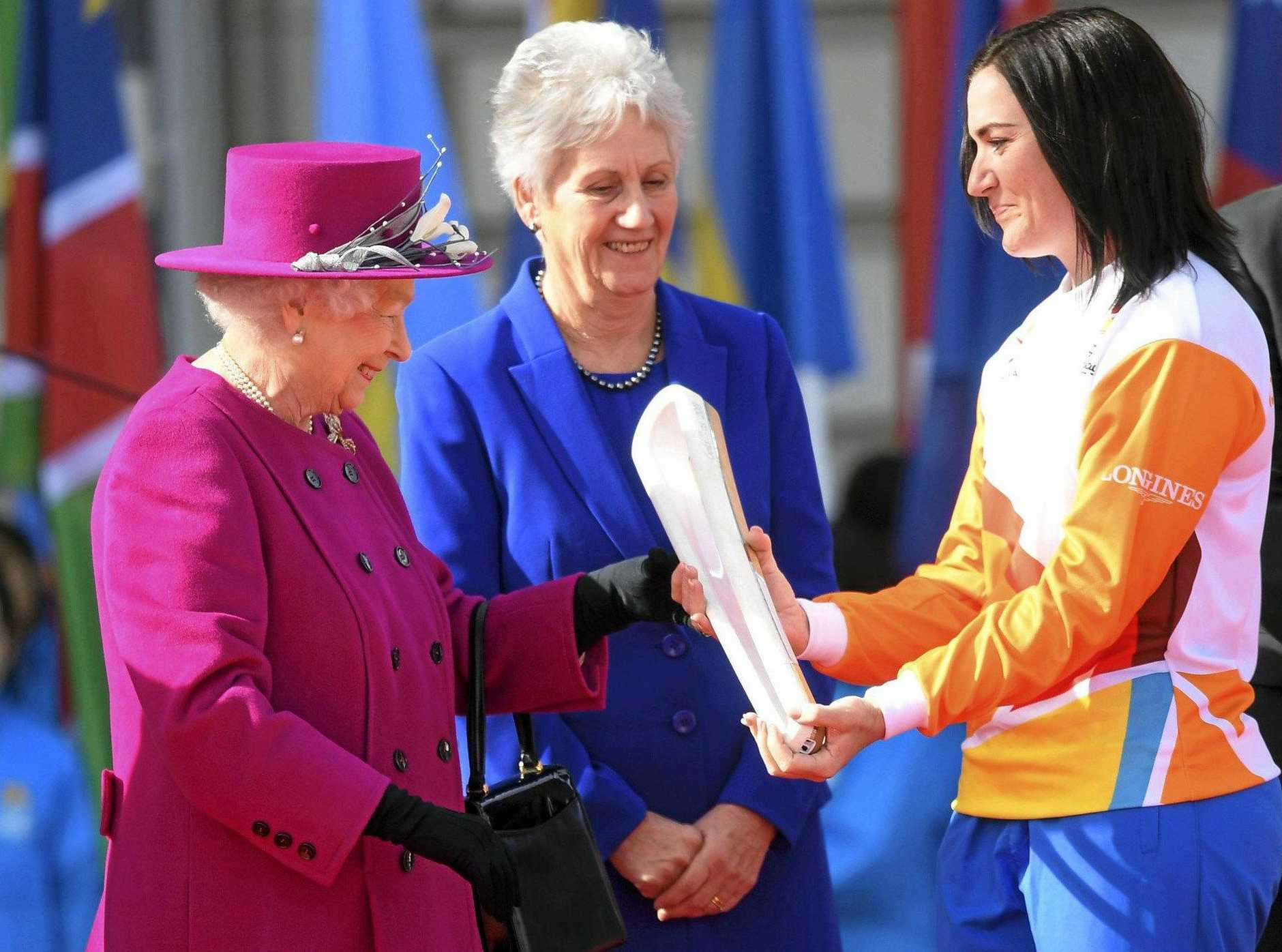 Retired cyclist Anna Meares, right, receives the Commonwealth Games relay baton from Britain's Queen Elizabeth II, left, at the launch of the relay at Buckingham Palace in London in May, 2017. The XXI Commonwealth Games are being held on the Gold Coast in Australia in 2018.