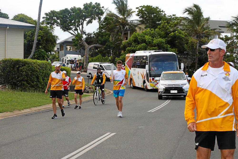 OVER THE MOON: Howard McDonald carrying the Commonwealth Games Queen's Baton on Monday.
