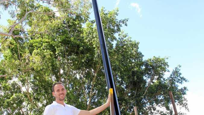 Youth and City Precinct Development Portfolio Councillor Daniel Sanderson checks out new solar lights installed in Brendan Hansen Park