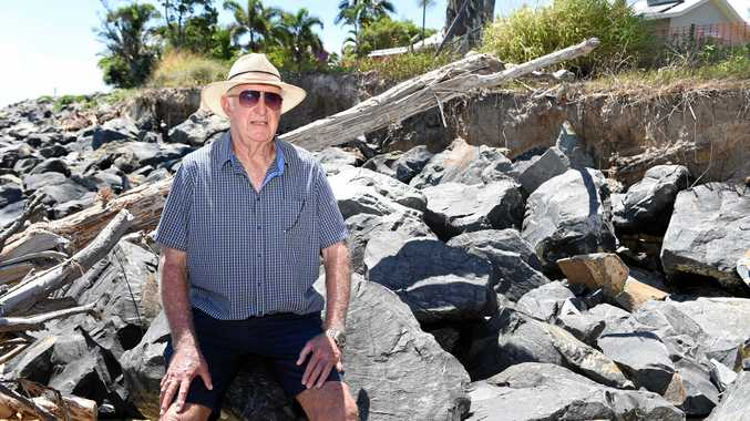 GRAVE CONCERNS: Toogoom resident Norm Hoffman at a section of the Toogoom rock wall which he believes is collapsing.