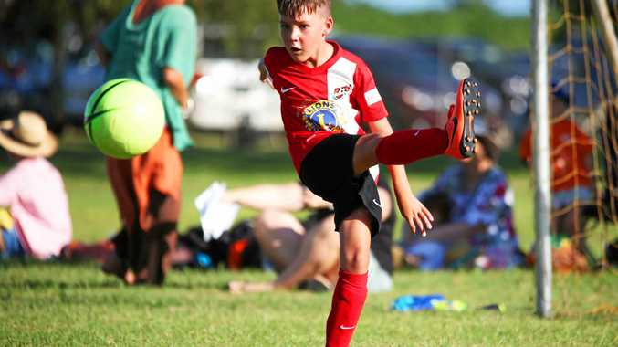 Under-9 Whitsunday FC player Ryan Pettigrew in action against the Proserpine Taipans on Friday afternoon.