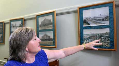 HANGING HISTORY: O'Mahony's Hotel publican Joan Wallace displays old postcards from Warwick.