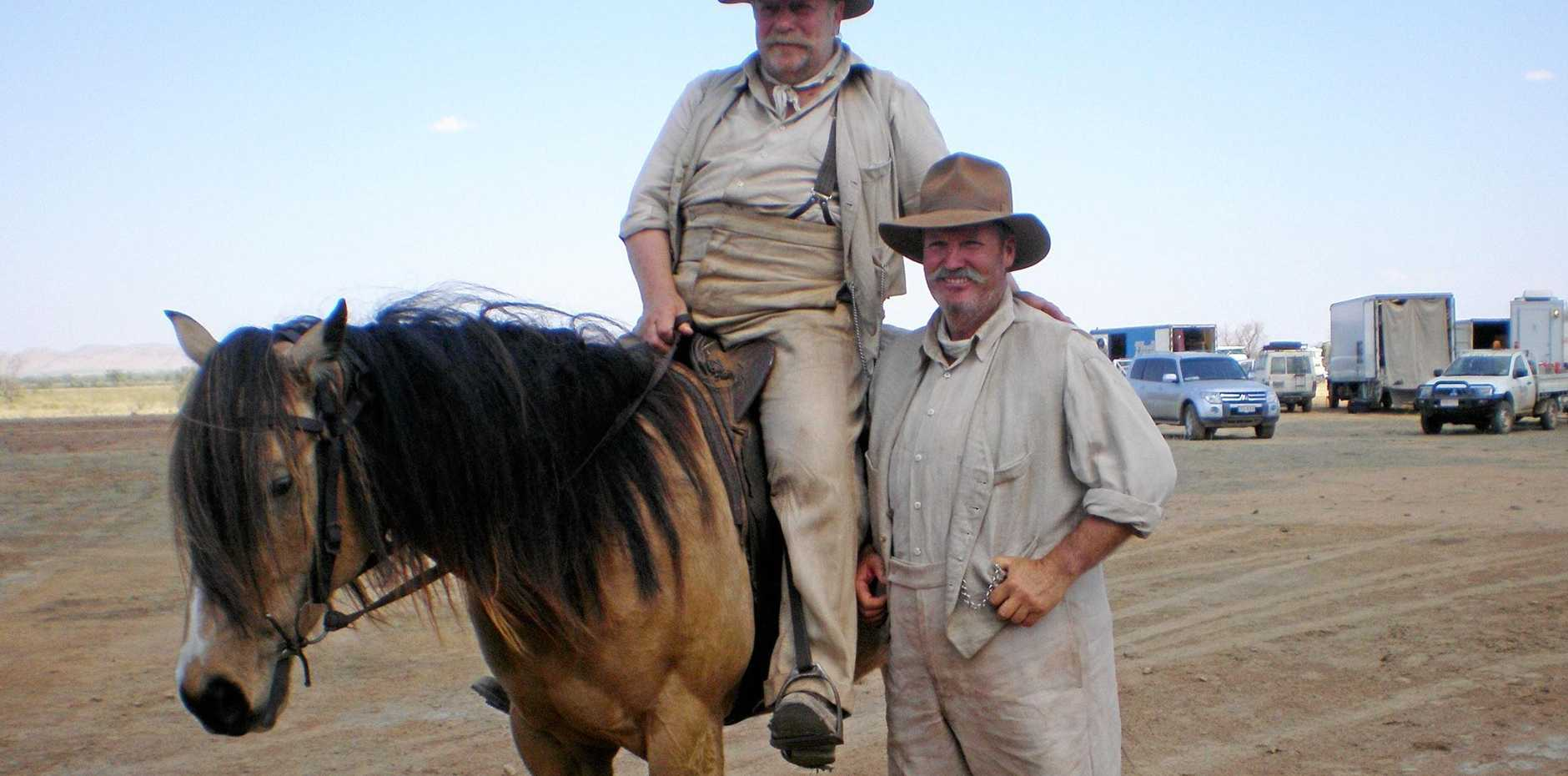 GIDDY UP: Actor Jack Thompson (on horse) takes some tips from Cowboy Up owner and horse riding teacher Peter Gould on the set of  Australia .