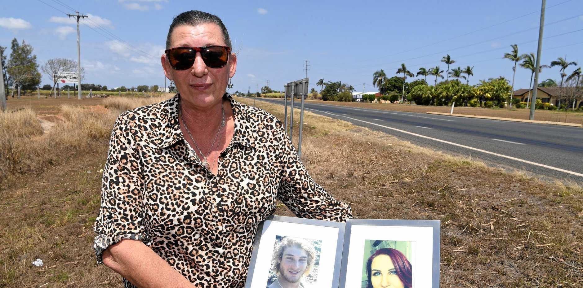 DEMANDING CHANGE: Kerri Walker with photos of her children Daniel and Sarah.