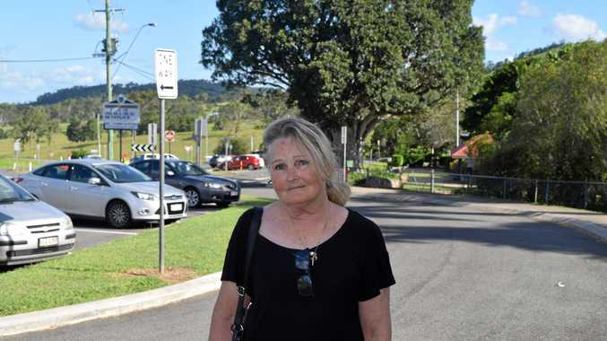 IT'S TIME FOR CHANGE: Sue Borghero stands in front of the bus zone Chatsworth State School, where cars are denied access.