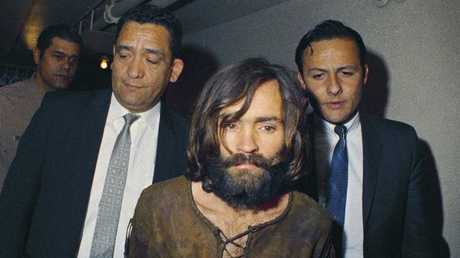 Charles Manson is escorted to his arraignment on conspiracy-murder charges in connection with the Sharon Tate murder case in 1969. Picture: AP