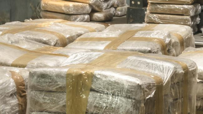 Police say they have seized drugs worth more than $100,000 and more than $32,500 in cash. .