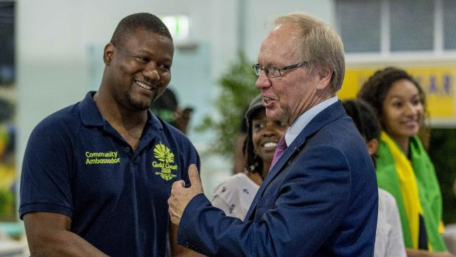 Marvin Wade Reed and GOLDOC chairman Peter Beattie at Brisbane Airport. Picture: Jerad Williams