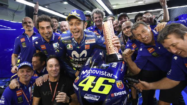 Valentino Rossi celebrating 3rd in the Qatar MotoGP with his crew. Pic: Yamaha