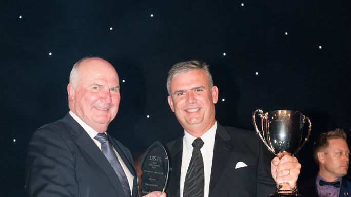 Brian Reid (left) presenting an award to Raine and Horne Toowoomba's Andrew Lynch.