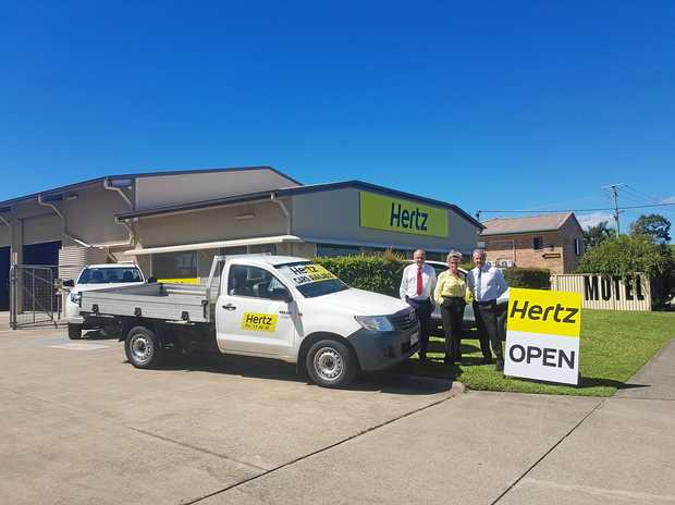 DRIVING A DEAL: Ray White Commercial Caloundra agents Len Greedy and Alan Gray with Hertz branch location manager Kim Steenbergen.