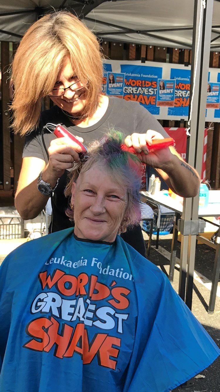 Sandy Kennedy mid shaving her head for a good cause at The Reef Gateway's St Patrick's Day celebrations on Saturday.