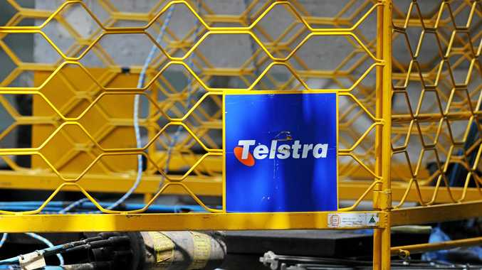 Telstra signage seen at a work site in Sydney. (AAP Image/Joel Carrett)