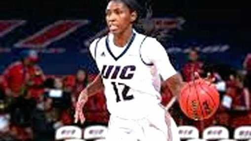 Mackay Meteorettes signing Ruvanna Campbell in her college days at the University of Illinois.