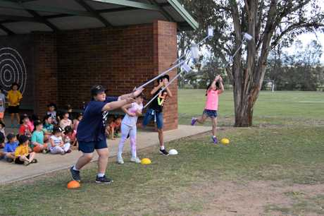 Glennie Heights State School students took part in broom throwing as a variation on caber throwing in Scotland.