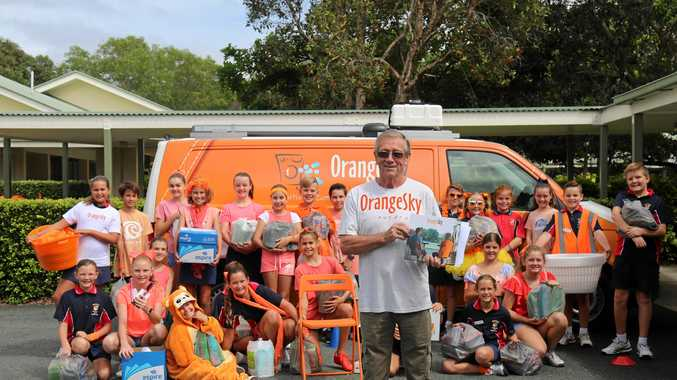 St Thomas More Catholic School, Sunshine Beach, students with Orange Sky Laundry volunteer vehicle manager Rob Scoates and some of the huge collections of items collected and donated to the cleaning service for the homeless.