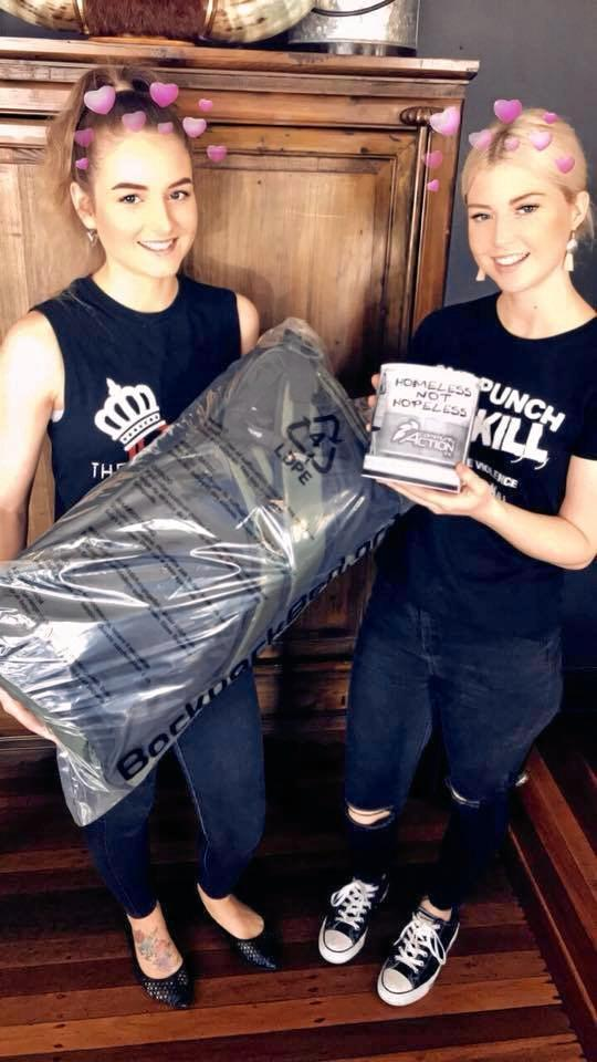 HELPING HAND: Royal Hotel workers Brooke Mercer (left) and Tiff Jones with an example swag for the homeless.