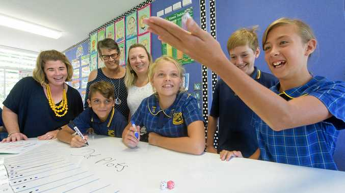STRONG SUPPORT: (From left) South Grafton Public School instructional leader Melissa Berry, Curriculum leader Years 3-6 Janelle Buckley, K-2 Rachel Clapham with students Callum Dalton, Isabelle Campbell, Noah Backwell-Geerin and Kayc Gilchrist get into some maths work.