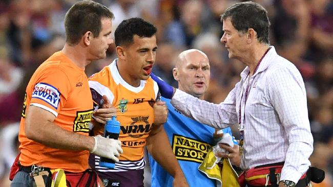 Jordan Kahu getting help from medical staff after being injured s at Suncorp Stadium. Photo: AAP Image/Darren England