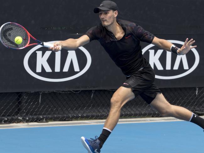 Bernard Tomic made an unsuccessful, low-key return to tennis.