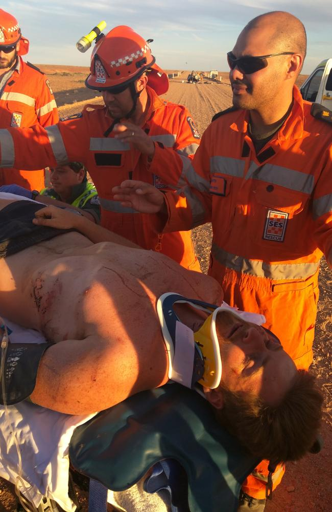 Oliver Walker being treated by paramedics after the crash. Picture: Brad Warren/Caters News