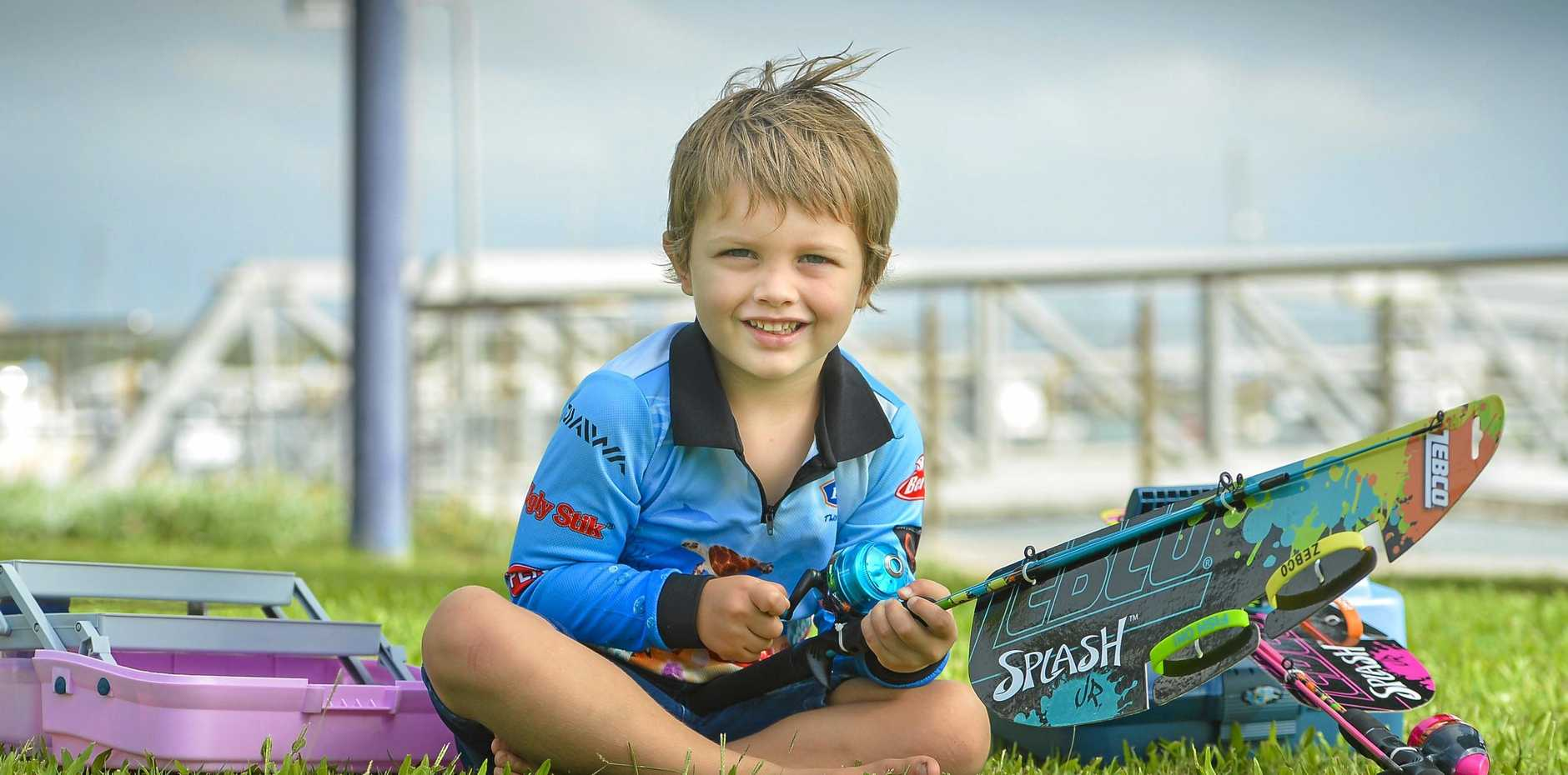 FISHING FRENZY: Carter Katsanevas shows off the gifts up for grabs in  The Observer's  Fishing Frenzy promotion.