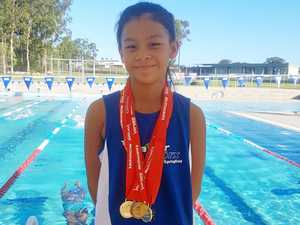Six gold medals keeps Hana stroking ahead