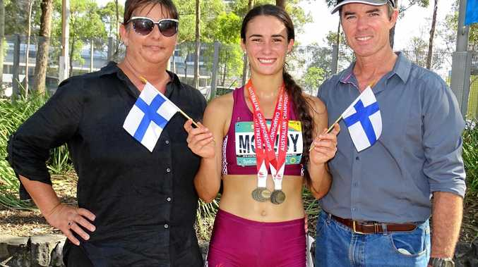 FINLAND-BOUND: Dual Ipswich and District Athletic Club gold medal winner Montanna McAvoy with parents Alicia and Mark at the Australian Junior Track and Field Championships.