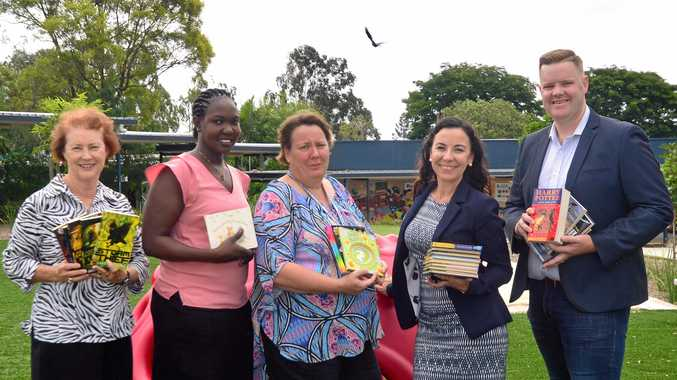 BOOK DRIVE: More than 700 donated books will be distributed amongst five Ipswich community hubs. L-R: Cr Sheila Ireland, Aleck, Katherine Hicks, Tracey Caruana and Steve Hodgson.