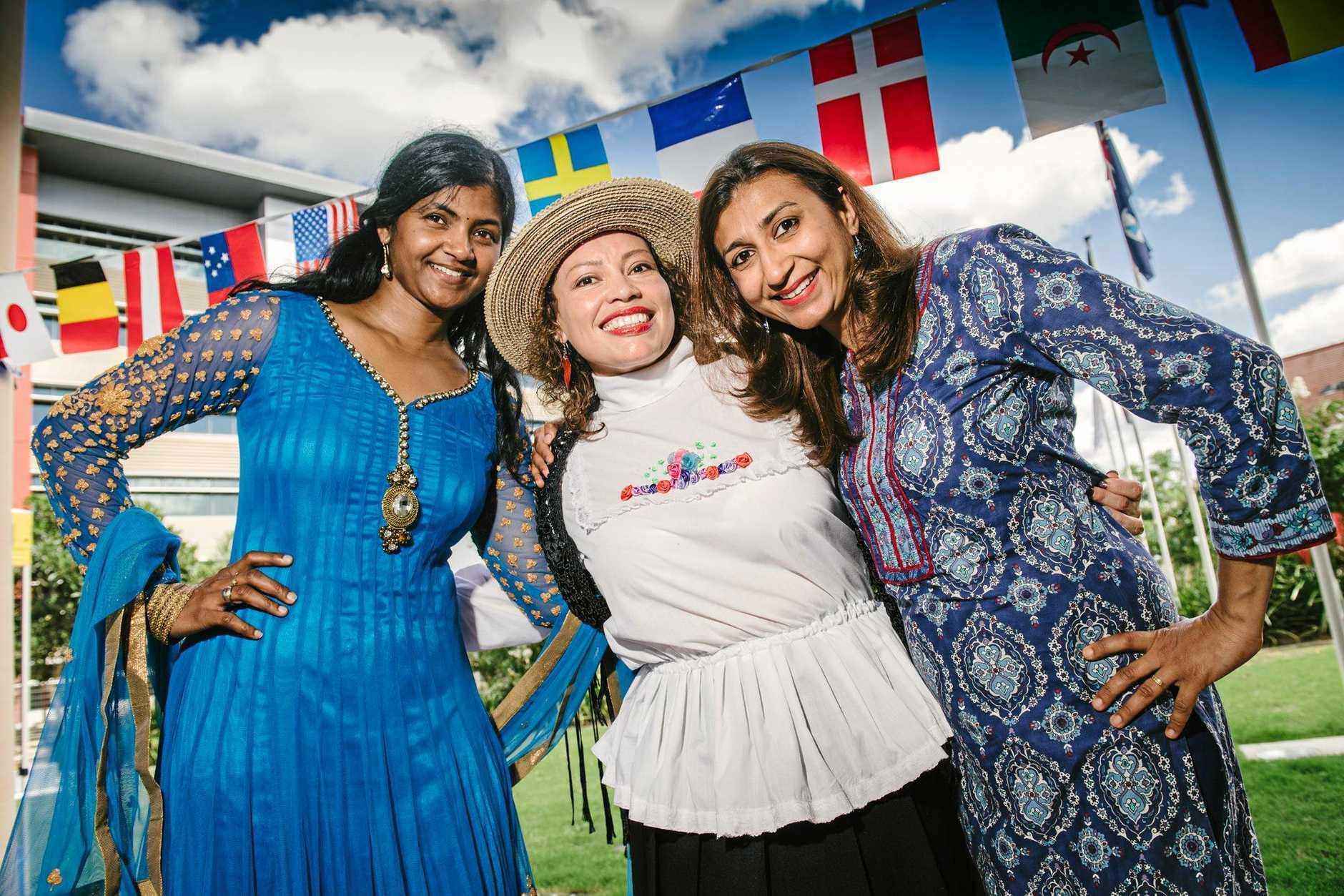 (L to R) Niyati Raval, Ranikanth Sadanala and Yira Nurey Cortes Mora celebrate Harmony Day at USQ Springfield.