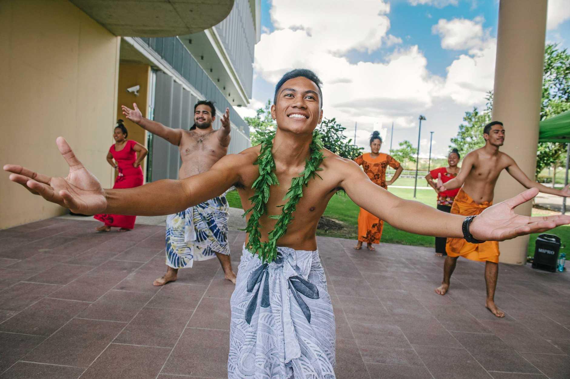 Dartagnyn Brown takes part in a Samoan dance.