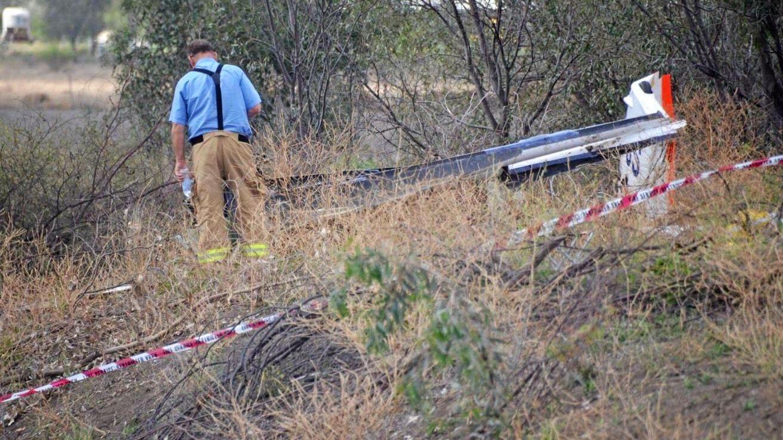 HORRIFIC SCENE: Investigators at the scene of the glider crash at Boggabilla, near Goondwindi, in which former Dalby man Simon Brown, 75, died.