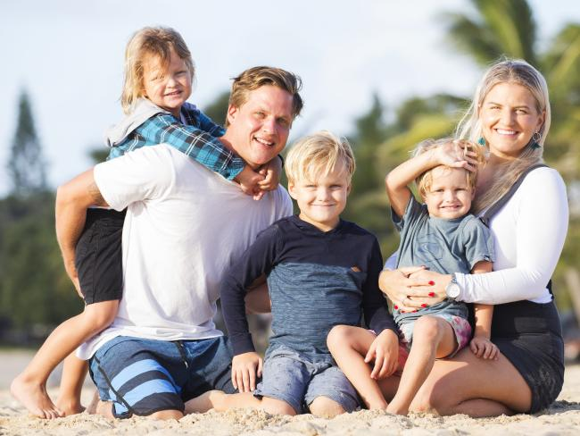 Chris Manners and Kathryn Trinder with sons Lucas, 3, Seth, 5, and Eli, 7, at Cotton Tree on the Sunshine Coast, could think of no better place to bring up their kids but Queensland. Picture: Lachie Millard