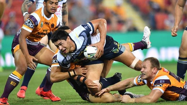 Jordan McLean (centre) in action for the Cowboys against the Brisbane Broncos at Suncorp Stadium. Photo: AAP Image/Darren England.