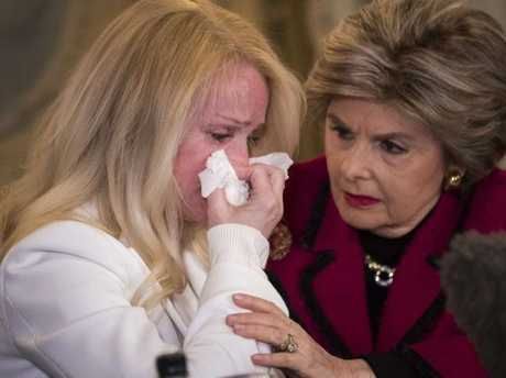 Rocxanne Deschamps is consoled by her lawyer Gloria Allred