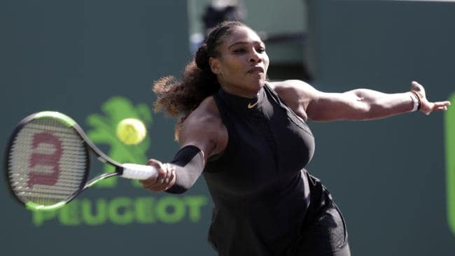 Serena Williams returns to Naomi Osaka.