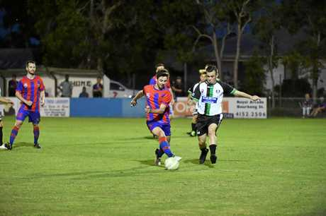 MAKING GROUND: Buccaneers player Shaun Mitchell battles against a Logan player during their game in Bundaberg on Saturday night.