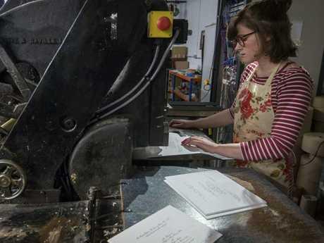 Lottie Small working the press of the royal wedding invites. Picture: Victoria Jones/Pool via AP.