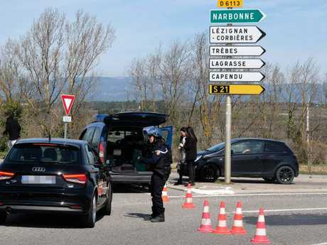 At least one person was feared dead after a gunman claiming allegiance to the Islamic State group fired shots in a hostage-taking at a supermarket in southwest France, police said. Picture:  AFP PHOTO / ERIC CABANIS